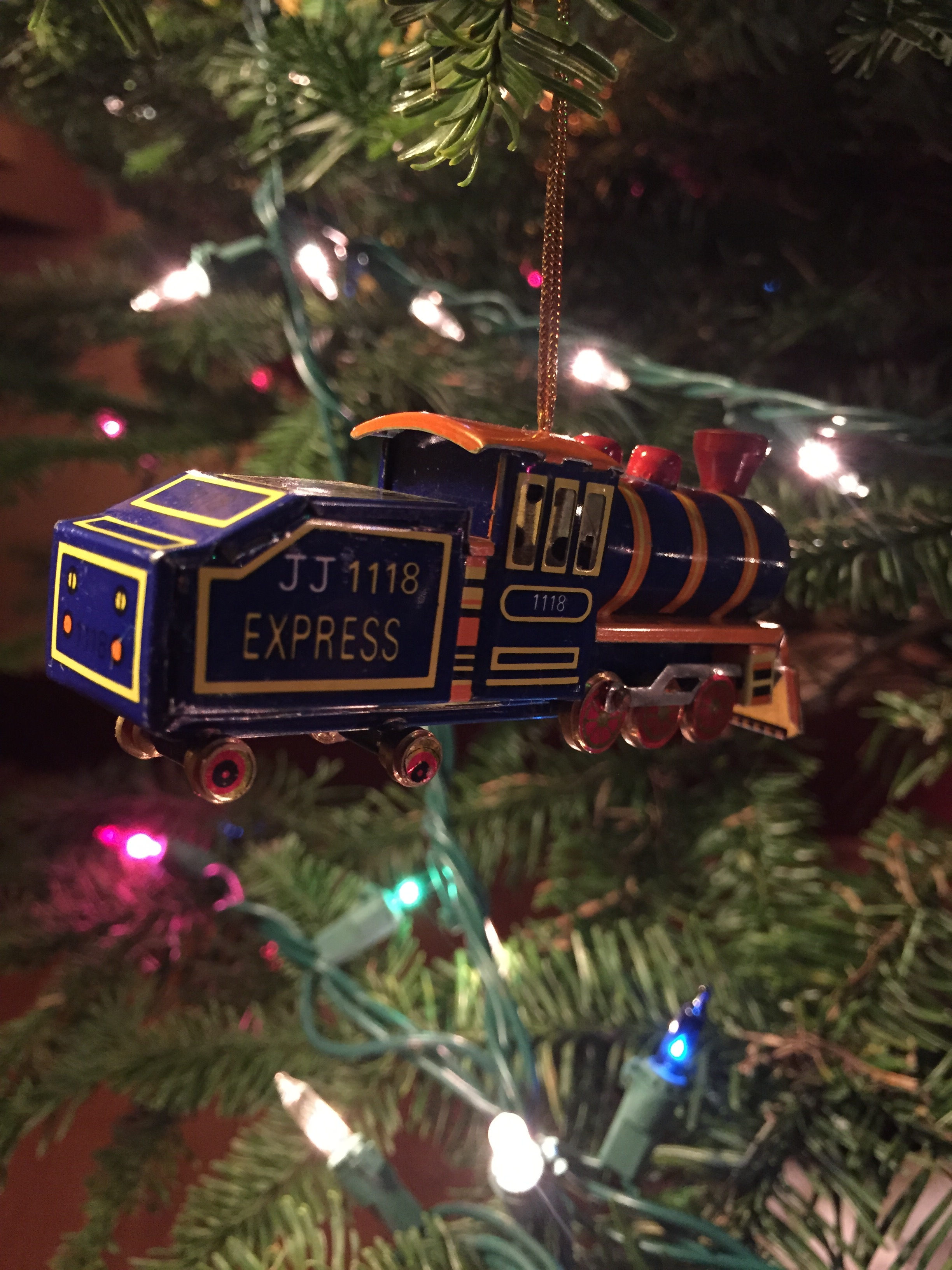 behold a train one of far too many christmas ornaments in our familys collection every year i try to cull through them the past few years ive been